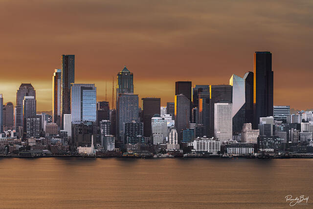 sunrise over Downtown Seattle from Alki beach