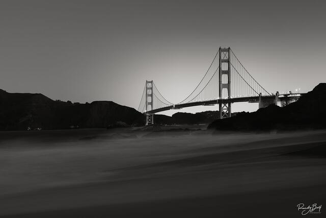 black and white golden gate bridge at sunrise.