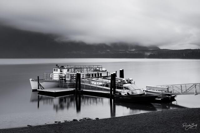 long exposure of lake McDonald lodge tour boats.
