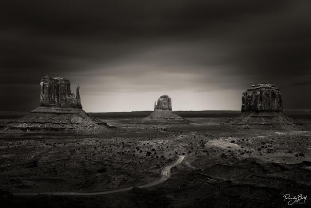black and white long exposure image of Monument Valley