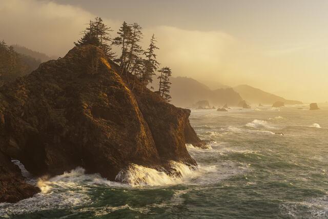 misty sunset at thunder rock overlook on the Oregon Coast.