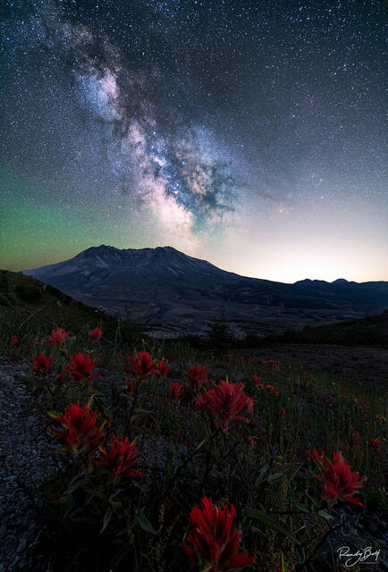 Milky Way galaxy over Mt. St. Helens national monument with the glow of Portland Oregon.