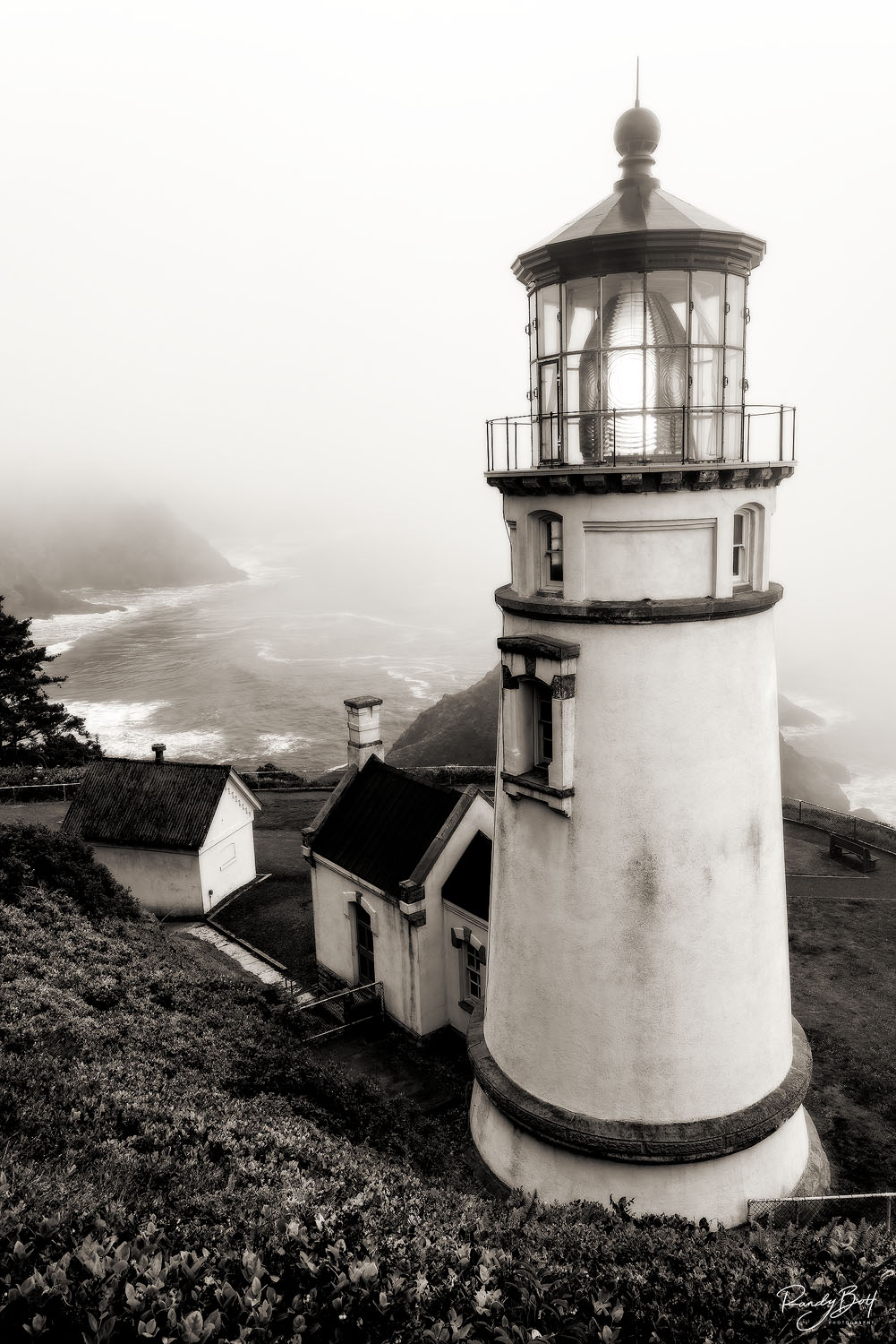 black and white vertical photograph of the Haceta Head Lighthouse.