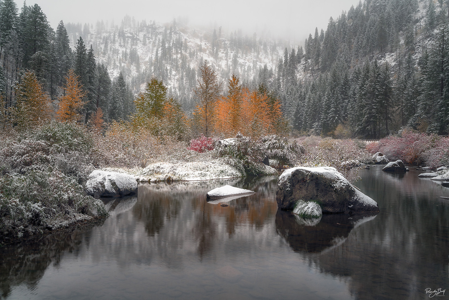 fall color and snow in the Tumwater canyon with snow near Leavenworth, Washington